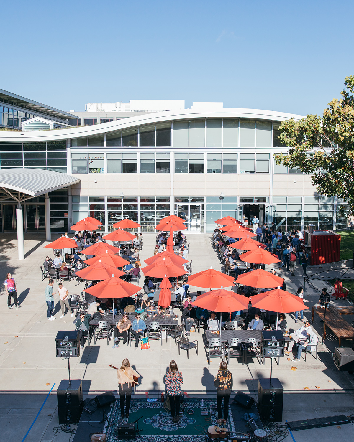 An aerial shot of the YouTube outdoor seating area, looking at the red patio umbrellas.