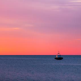 Lonely boat by Adrijan Pregelj - Landscapes Sunsets & Sunrises ( samll, sunset, summer, orange sky, boat, watter )
