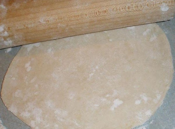 Then I sprinkled flour over my counter and my rolling pin. I separated the...