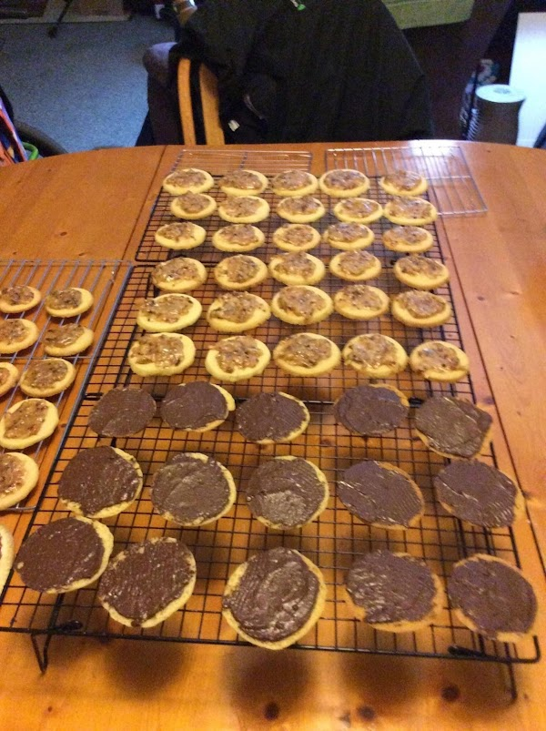 For coating, melt chocolate chips. Spread bottom of cookies with chocolate . Let stand...