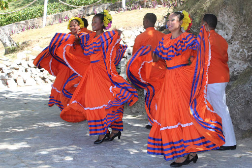 Cuba-Women-Dancing-in-Bright-Red-Dresses.jpg - Cultural exchanges include exposure to local artists, musicians and dancers.
