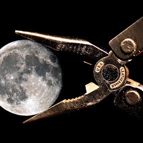 I've captured a moon by Siew Feun Kylemark - Artistic Objects Still Life ( pwcstilllife-dq, macro, moon, still life, tool, capture, piler, optical illusion, forced perspective )