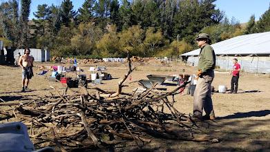 Photo: Peter Hirst demonstrate methods for constructing biochar conservation burns.