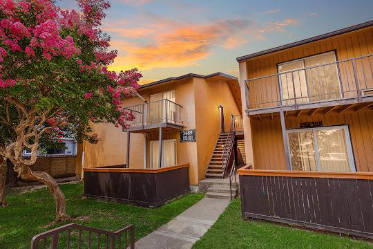 Apartment building with orange siding at dusk