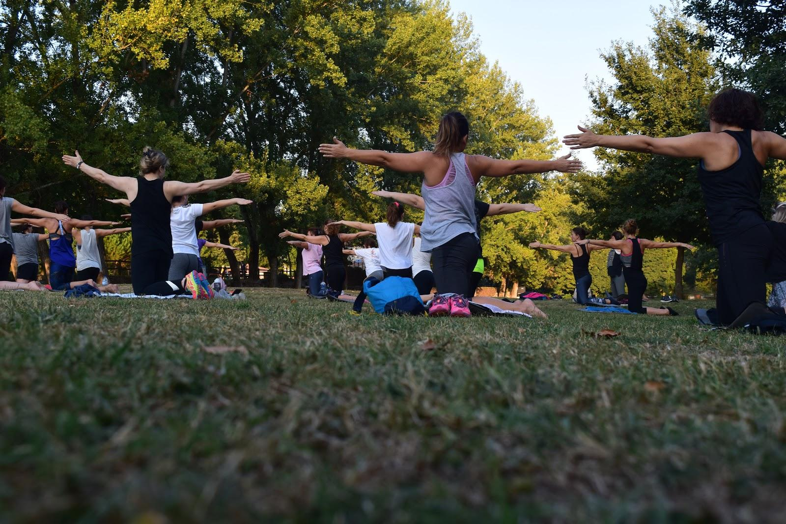 Practising yoga at park