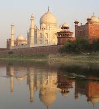 """Photo: The Taj Mahal seen from the banks of the river Yamuna.  The Taj Mahal is a white marble mausoleum located in Agra, India. It was built by Mughal emperor Shah Jahan in memory of his third wife, Mumtaz Mahal. The Taj Mahal is widely recognized as """"the jewel of Muslim art in India and one of the universally admired masterpieces of the world's heritage""""  For #sacredsunday curated by +Manfred Berndtgen+Robyn Morrison +SacredSunday™ +Margaret Tompkins& +Sherrie von Sternberg"""