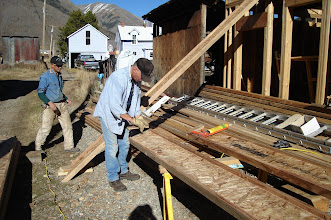 Photo: Loren and Terry preparing truss joists for the roof. Now mid-October.