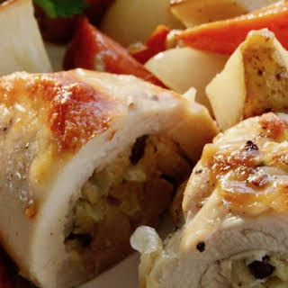 Stuffed Chicken Thighs with Roasted Potatoes and Carrots.