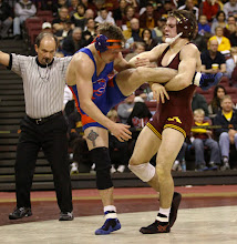 Photo: 133 – #6 Chris Dardanes, Minnesota, dec. #12 Brian Owen, Boise State, 9-2. Photo by Mark Beshey.