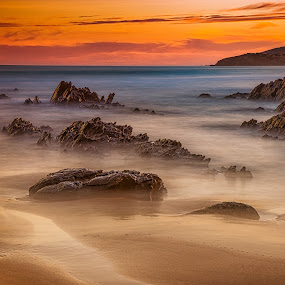 When the sun goes down by Nicole Rix - Landscapes Sunsets & Sunrises ( sunset, warmth, seascape, beach, rock formation,  )