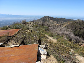 Photo: View south from Sunset Peak toward Culver Peak and the Pomona Valley beyond. The corrugated steel was for water collection.