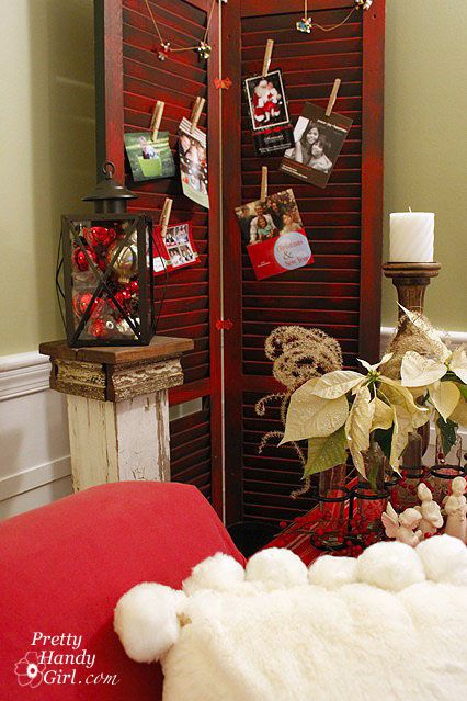 Shutter Card Holder: These 25 DIY Christmas Card Holders - That Double As Festive Decor will allow you to beautifuly display your cards and will also give you some great decor.
