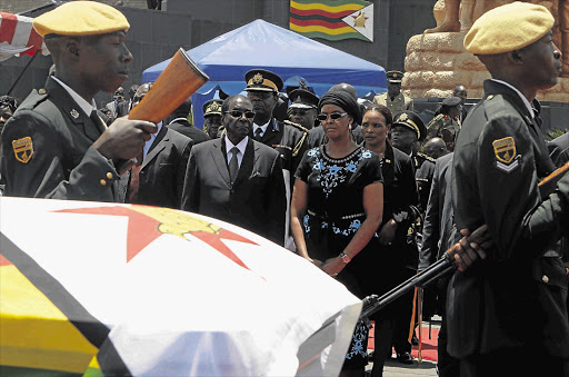 President Robert Mugabe and his wife, Grace, attend the funeral of the vice-president, John Nkomo, in Harare, Zimbabwe.