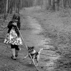 Stick fight by Ruth Holt - Black & White Street & Candid ( child, stick, forest, dog, walk, woods, broughton woods )