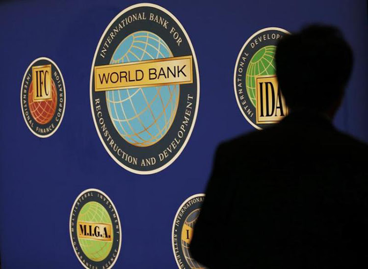 A man is silhouetted against the logo of the World Bank at the main venue for the International Monetary Fund and World Bank annual meeting in Tokyo in October 2012. Picture: REUTERS