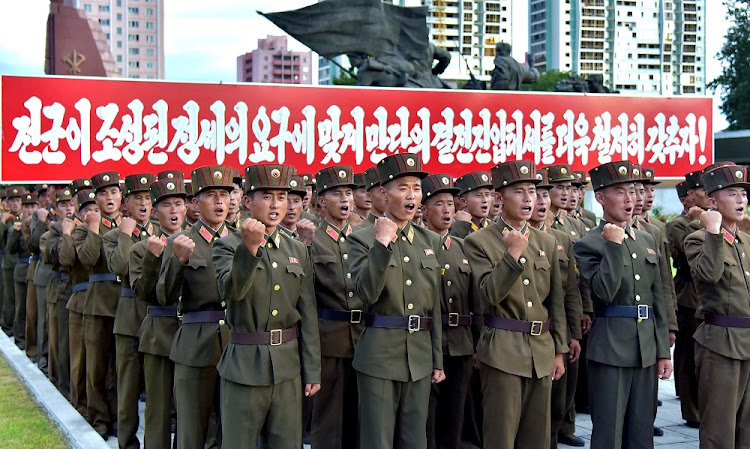 North Korean servicemen march in a show of strength in Pyongyang. Picture: KCNA/REUTERS