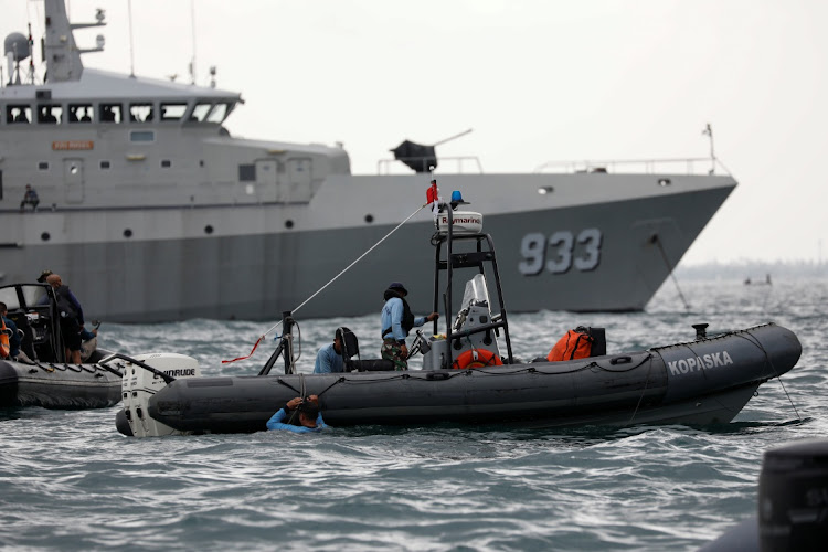 Indonesian navy divers, seen here on a rubber boat next to Indonesian naval warship KRI Rigel 933 off the Jakarta coast, Indonesia. On January 12 2021, hey retrieved the black boxes of the crashed Sriwijaya Air Boeing jet. Picture: REUTERS/WILLY KURNIAWAN