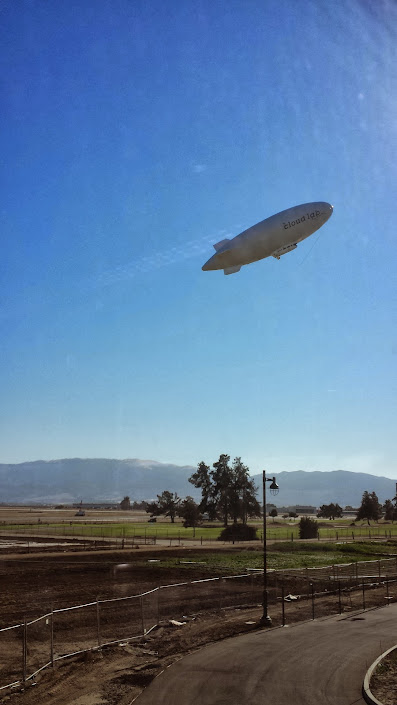 A blimp taking off outside Hartnell College