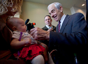 Photo: Republican presidential candidate Ron Paul meets Aline Olthafer-Lange and her 3-month-old daughter, Heidi, during a campaign stop Dec. 22 at the Grand River Center in Dubuque, Iowa. Photo by Rodney White, The Des Moines Register.