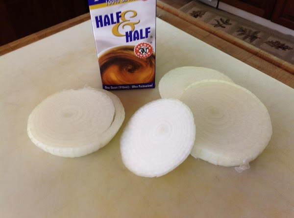 Place onions in a bowl and pour half and half over onions.  Mix...