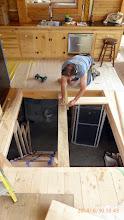 Photo: Bldg. the floor/trap door ...