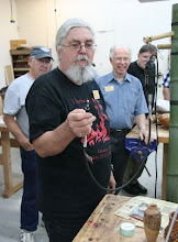 Photo: Ed Karch constructed a grinder hanger out of a bamboo tube mounted on the wheel assemby from a desk chair.