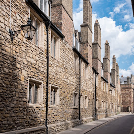 Cambridge scenes #2 by Tomasz Karasek - City,  Street & Park  Historic Districts ( blue sky, street, cambridge, narrow, clouds, stone )