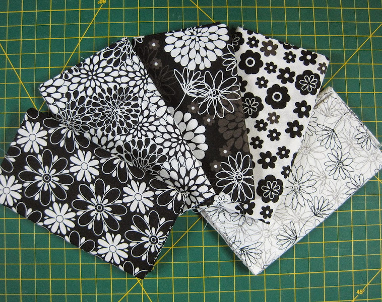 Photo: I buy these packs of fat quarters at Joann Fabrics - they're nice quilting cotton, usually $9.99... or less if you have a coupon. This pack was $5.99, so the material cost for 4 bags would be $1.50 each.