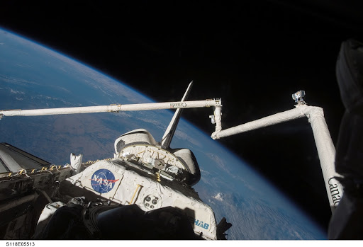 View of the Payload Bay,Vertical Stabilizer,and RMS/OBSS taken during STS-118