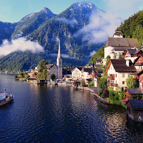 First boat in Hallstatt by Stefano Landenna - Landscapes Travel ( cool, reflection, mountain, church, lake, hallstatt, boat, austria )