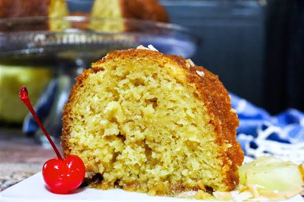 A Slice Of Tropical Pineapple Coconut Rum Cake On A Plate.