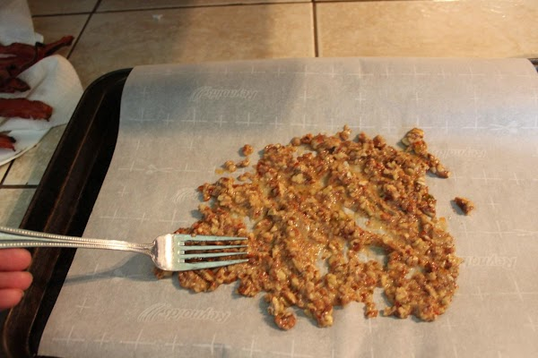 Separate pecans with a fork; cool.