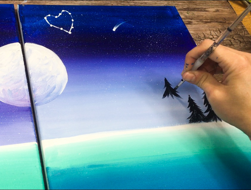 Hand painting a couples painting canvas for at home date night