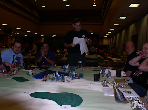 Photo: David Kuijt (standing) of the Japanese Defense Forces - JDF (Tony Aguilar is sitting to his left) reads the rules to the group as the battle for Tokyo and the world is about to begin!