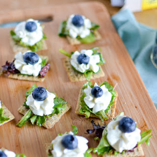 Triscuit Crackers topped with Balsamic Mixed Greens, Whipped Goat Cheese & Blueberries.