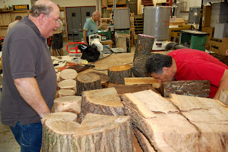 Photo: Carl Powel looks on as Clif Poodry preforms the smell test to determine the type of wood.