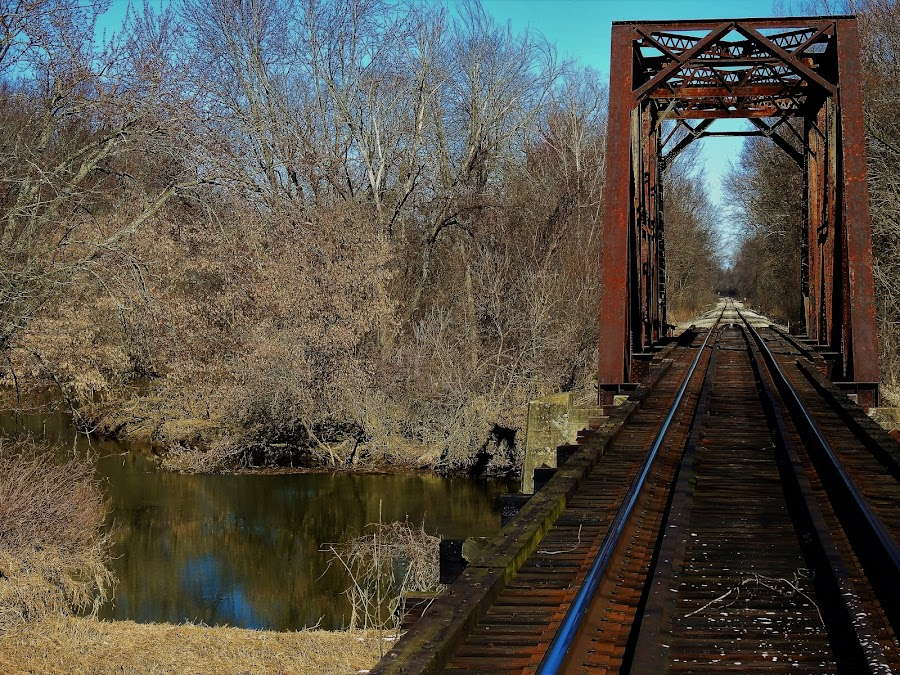 The Tracks Less Traveled by Kathy Woods Booth - Buildings & Architecture Bridges & Suspended Structures ( train tracks, reflections, bridge, landscape, river )