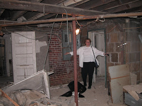 Photo: October 2003 - Month 2: Laura expressing complete dismay at the old mechanical room - now Room 101