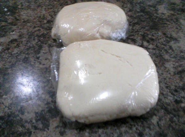 Divide dough in half, wrap in plastic wrap and put in fridge for at...