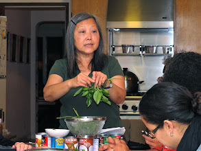 Photo: Kasma shows how to prepare Thai basil for curry dishes