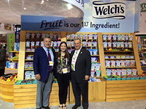 Photo: Kylee at the Sweets & Snacks Expo in Chicago with Michael Rosenberg (right) and Robert Taylor (left).