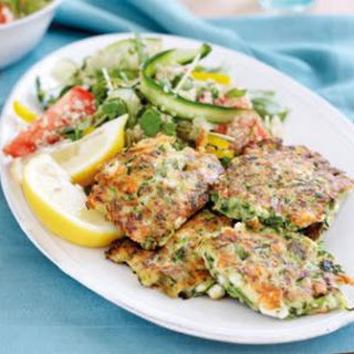 Zucchini And Feta Fritters With Quinoa Salad.