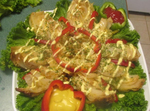 Now drizzle wedges with soft squeeze margarine, then sprinkle with chopped chive. Place red...