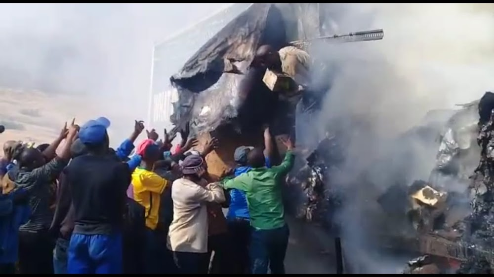 Image result for photos looters eastern cape 2019 august burning truck