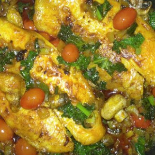 Red Palm Oil, Fish Fillet with Mushrooms & Kale..