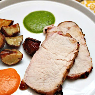 Grilled Pork Loin With Wrinkled Potatoes, Mojo Verde, and Mojo Picón.