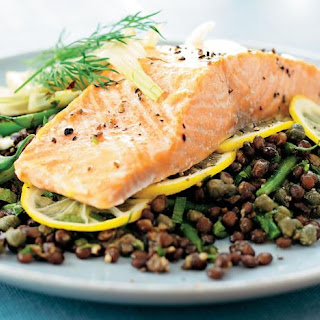 Salmon and Puy lentils with parsley.