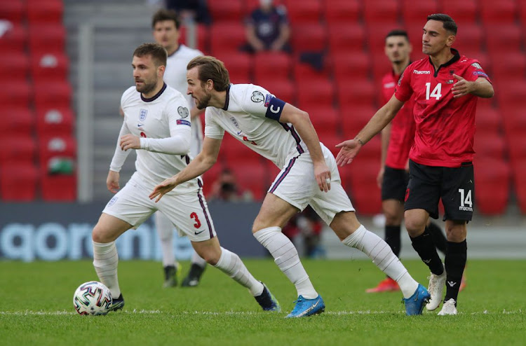England's Harry Kane and Luke Shaw in action with Albania's Qazim Laci in the World Cup Qualifier at Arena Kombetare, Tirana, Albania on March 28, 2021