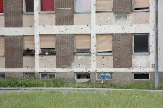 Photo: Day 77 - These are the Flats on the Left and They Still have Artillery Damage & the Flats are Inhabited