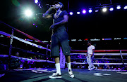 Rapper Nipsey Hussle performs before a boxing match.